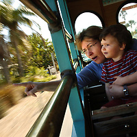 (02.03.2005)(PHOTO/CHIP LITHERLAND) -- Claire Fripp of Montreal, Canada, and her son, Rory, 2, point out orange trees in the front yard of a home while riding the free trolley throughthe city of Anna Maria on Anna Maria Island during their 10-day vacation Thursday, February 3, 2005.