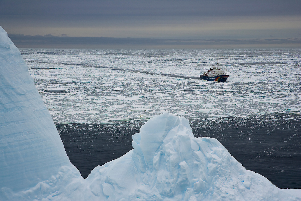 February 14th 2007. Southern Ocean. Greenpeace's M.Y. Esperanza cruises past an iceberg in the Ross Sea.