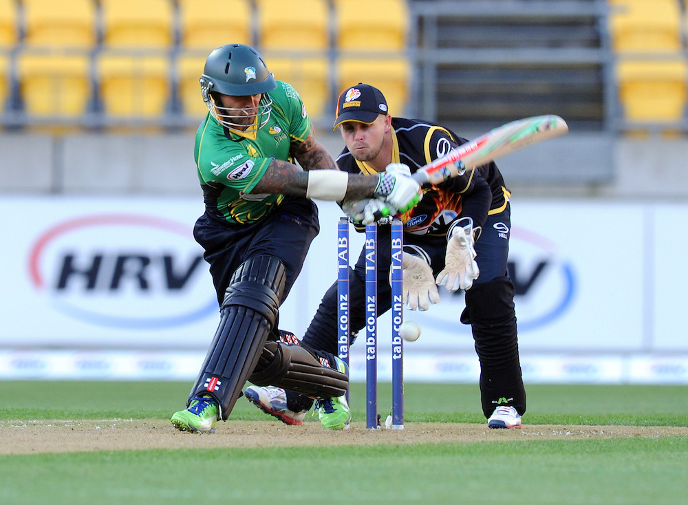 Central Stags Peter Trego bats in front of Wellington Firebirds Michael Pollard in the HRV T20 cricket match at Westpac Stadium, Wellington, New Zealand, Friday, November 22, 2013. Credit:SNPA / Ross Setford