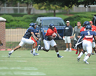 Ole Miss running back Nicholas Parker (4) at football practice in Oxford, Miss. on Sunday, August 4, 2013.