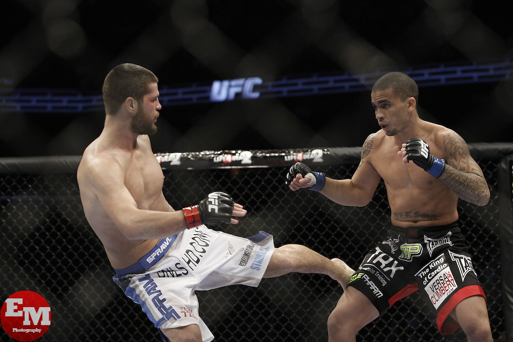 Dec 12, 2009; Memphis, TN, USA; Matt Wiman and Shane Nelson during their bout at UFC 107 at the FedEx Forum in Memphis, TN.