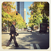 2016 September 22 - A man crosses 4th Ave at James St. in downtown Seattle, WA. By Richard Walker