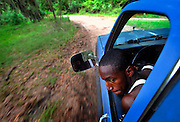 Twenty-one-year-old Brandon Dixon drives a pick-up truck through the dirt streets of Hog Hammock, Thursday, Aug 23, 2012, on Sapelo Island, Ga. The roads in the African Geechee-Gullah community are simple dirt roads without traffic signs, marking or lighting. Property owners are facing higher taxes, and fees from the county threatening an already fragile community. (Stephen Morton for The New York Times)
