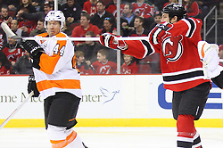 Mar 13, 2013; Newark, NJ, USA; New Jersey Devils center David Clarkson (23) tries to deflect a shot while Philadelphia Flyers defenseman Kimmo Timonen (44) defends during the first period at the Prudential Center.