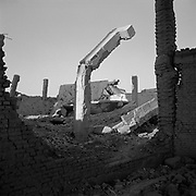 Destroyed building supports and structures adjacent to the main building at Tarnak Farms, the al Qaeda base, training camp and pre 9/11 al Qaeda headquarters in Kandahar, Afghanistan which served as a home to Osama Bin Laden and numerous al Qaeda fighters located outside Kandahar City. It is believed that this base was where the plan for the 9/11 attacks originated, as a result Tarnak Farms was heavily bombed by the United States after September 11, 2001. (Credit Image: © Louie Palu/ZUMA Press).