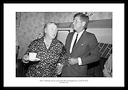 Kennedy in Ireland.  President Kennedy visits the homestead of his great-grandfather at Dunganstown, Co. Wexford and drinks a cup of tea with the present owner of the cottage, a second cousin of the President, Mrs. Mary Ryan (ne&eacute; Kennedy).<br />