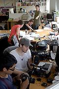 Getup office in Sydney with National Director Simon Sheikh. Creative Director Simon Duncan Watt and intern Vonne Patiag organising their equipment.