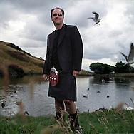 Ken Misch, a native of Las Vegas, USA, wearing a kilt from 21st Century Kilts, in Edinburgh's Holyrood Park, .Scotland, UK.