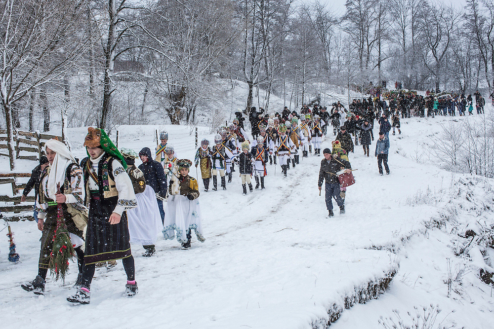 Revelers in costume celebrate the Malanka Festival on Thursday, January 14, 2016 in Krasnoilsk, Ukraine. The annual celebrations, which consist of costumed villagers going in a group from house to house singing, playing music, and performing skits, began the previous sundown, went all night, and will last until evening.