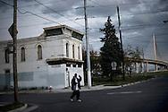 OHIO, Toledo, October 28, 2012:  A man walks near by a disused restaurant in North-East Toledo. ALESSIO ROMENZI