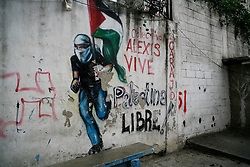 A painting in the 23 de Enero shows support for the Palestinian struggle. Paintings in support of Palestinians can be found across Caracas.
