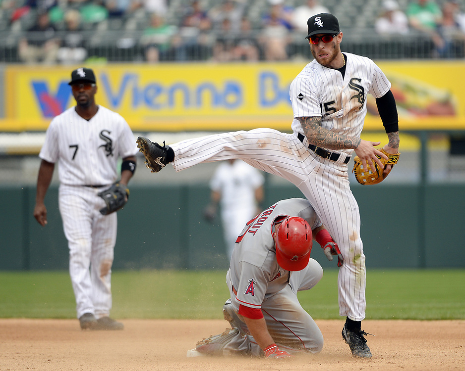 CHICAGO - APRIL 21:  Brett Lawrie #21 of the Chicago White Sox turns a double play over the sliding Mike Trout  #21of the Los Angeles Angels of Anaheim in the eighth inning on April 21, 2016 at U.S. Cellular Field in Chicago, Illinois.  The Angels defeated the White Sox 3-2.  (Photo by Ron Vesely)   Subject: Brett Lawrie; Mike Trout