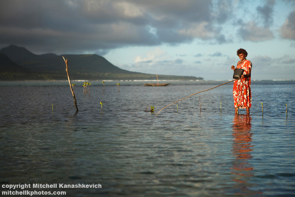 Woman fishing in the lagoon that separates Rah and Mota Lava Islands. Banks Island group, Torba province, Vanuatu. Rah Lava Island, Torba Province, Vanuatu