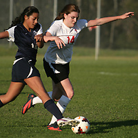 Cape Fear's Nansi Holt attempts to advance the ball past Coastal Christian's Emilee Beadore. (Jason A. Frizzelle)