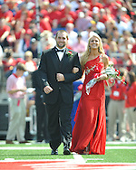 Sophomore maid Britt Buchanan (right) is escorted by Ole Miss baseball player Sam Smith at Ole Miss vs. Auburn at Vaught-Hemingway Stadium in Oxford, Miss. on Saturday, October 13, 2012.