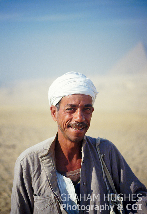 Trader At Giza, Egypt. Great Pyramid In Background.