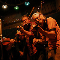 Fiddle player Daryl Angor shares the stage at Pickathon, the annual roots music festival near Portland, Oregon.