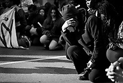 Marchers stop to pray during a rally after a prosecutor said that a police officer will not face charges in the fatal shooting of an unarmed 19-year-old biracial man, in Madison, Wisconsin May 12, 2015. Tony Robinson Jr. was shot in the head, torso and right arm by Officer Matt Kenny, who police have said was responding to a report that a man who had battered someone was dodging traffic in the street when he encountered Robinson. REUTERS/Ben Brewer