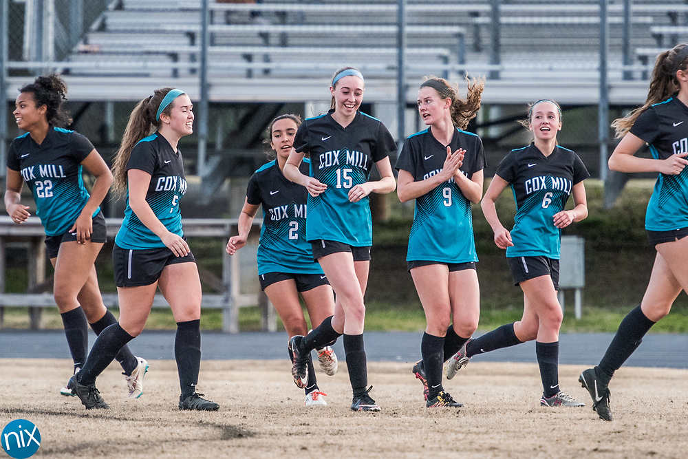 Cox Mill's Madison Greenhall (15) and teammates celebrate a goal against Jay M. Robinson Monday night at Jay M. Robinson High School. Cox Mill won the game 5-0.