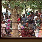 Togolese refugees waiting at a UNHCR food distribution centre in the Ghanaian Volta region. Thousands of Togolese citizens crossed the border into Ghana after the violence that followed presidential elections in April 2005. Partly because of strong cultural ties between populations on both sides of the border, Togolese refugees were able to enjoy the relative hospitality of their Ghanaian neighbours, and are today scattered in various villages across the border. The UNHCR complains that, since the refugees aren't concentratred in large camps, media attention has been minimal, and that it has been very difficult to attract funding.