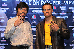 Sept 19, 2012; New York, NY, USA; Manny Pacquiao and Juan Manuel Marquez pose during the press conference announcing their fourth fight at The Edison Ballroom.