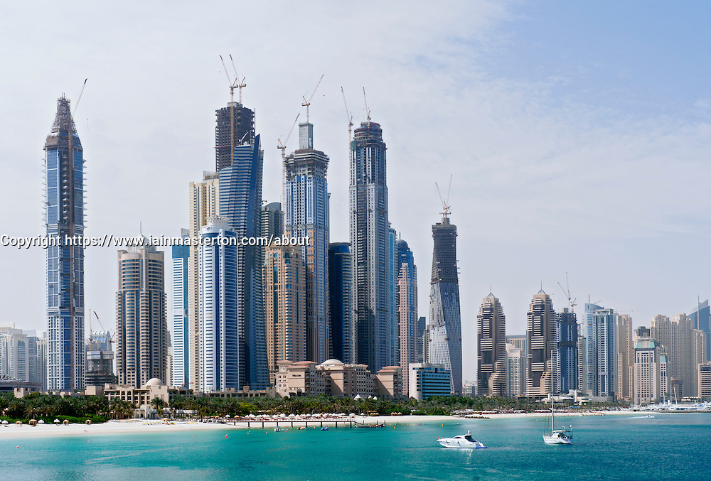 Skyline with many new apartment towers under construction at Dubai Marina district at Jumeirah Beach resort in Dubai, United Arab Emirates, UAE
