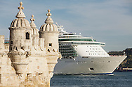 A cruise ship passes by Belém Tower in Lisbon. The Tower was classified as a UNESCO World Heritage Site in 1983 and included in the registry of the Seven Wonders of Portugal in 2007. It was built in the early 16th century and is a prominent example of the Portuguese Manueline style. Lisbon is nowadays one of the harbours in Europe with more cruise ships stoping by.