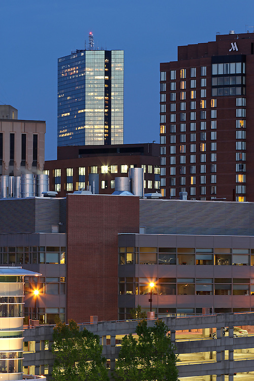 Cambridge skyline photography at twilight showing landmarks such as Biotech giant Biogen Idec, Marriott Hotel, John Hancock building in Boston. Cambridge is a unique community with a strong mix of culture, demographic and social diversity, intellectual vitality and cutting-edge technological innovation. Cambridge is a major hub for leading biotechnology companies. It is one of the world's most important centers for biotech research, not only because it is a great place to live, work and to enjoy a diverse array of cultural activities, but also because it has access to an unmatched pool of talent and a wealth of institutional resources from its world-renowned educational institutions, Harvard University and the Massachusetts Institute of Technology (MIT). For biotechnology, it is &quot;the place to be.&quot;<br /> <br /> This Cambridge, MA photography picture of the Biogen Idec headquarter is available as museum quality photography prints, canvas prints, acrylic prints or metal prints. Prints may be framed and matted to the individual liking and wall decoration needs:<br /> <br /> http://juergen-roth.artistwebsites.com/featured/biogen-idec-in-cambridge-juergen-roth.html<br /> <br /> Good light and happy photo making!<br /> <br /> My best,<br /> <br /> Juergen<br /> http://www.exploringthelight.com<br /> http://www.rothgalleries.com<br /> @NatureFineArt<br /> http://whereintheworldisjuergen.blogspot.com/<br /> https://www.facebook.com/naturefineart