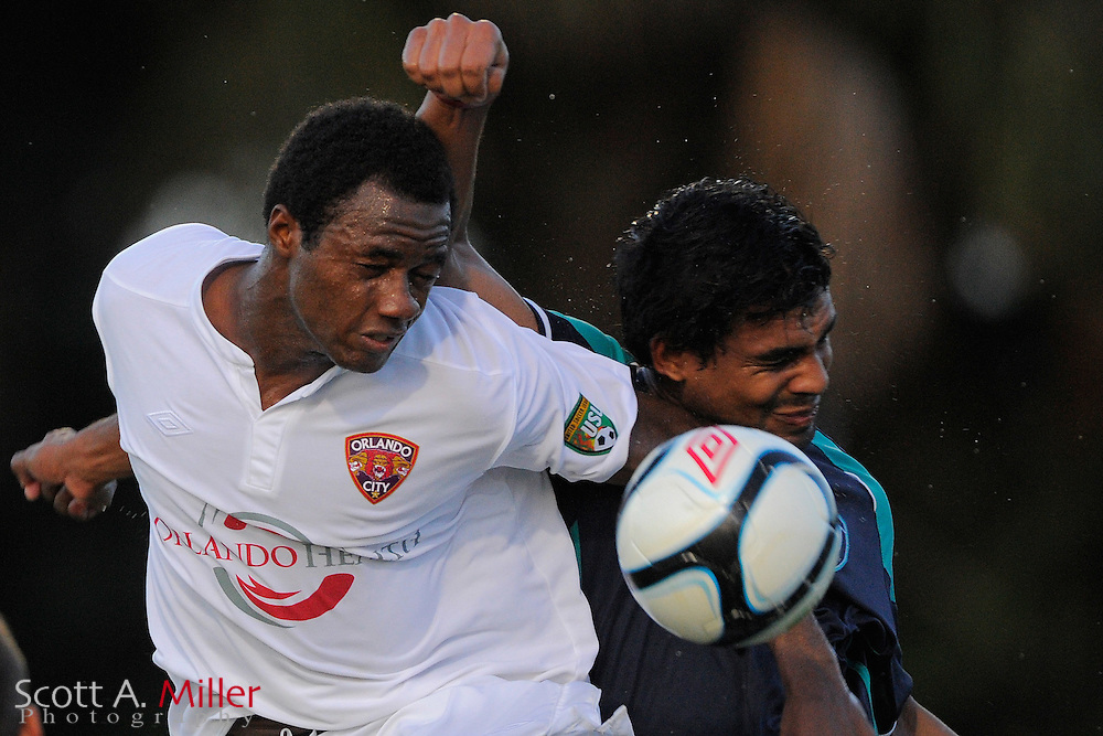 Orlando City defender Oumar Diakhite (25) and VSI Tampa Flames forward Carlos Tenorio De Araujo (10) go airborne for a ball during their Development League game against the VSI Tampa Flames at the Seminole Soccer Complex on July 13, 2012 in Sanford, Florida. ..©2012 Scott A. Miller