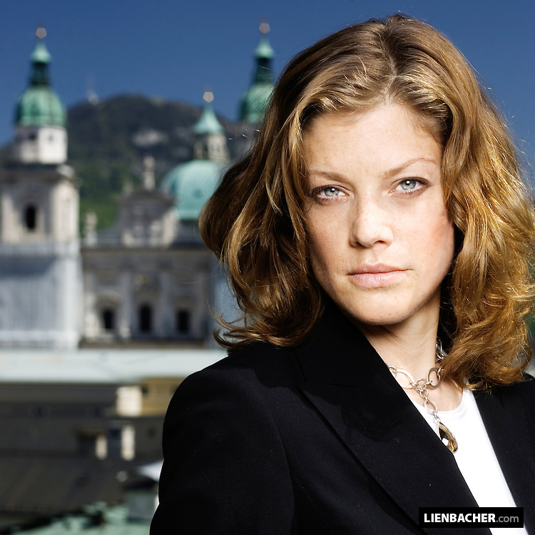 German actress Marie Bäumer in front of salzburgs old town.