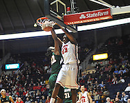 Mississippi's Reginald Buckner (23) dunks over Mississippi Valley State's Montrell Holley (42) in Oxford, Miss. on Friday, November 9, 2012. (AP Photo/Oxford Eagle, Bruce Newman)