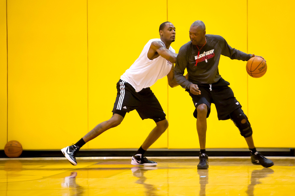 MIAMI, FL -- January 29, 2012 -- Miami center Mickell Gladness, left, practices defensive drills in the Heat's practice gym with assistant coach Keith Askins prior to their 97-93 win over the Chicago Bulls at American Airlines Arena in Miami, Fla., on Sunday, January 29, 2012.  (Chip Litherland for ESPN the Magazine)
