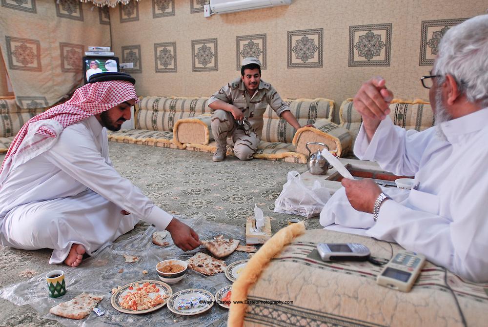 Sheikh Naser Al Irq speaking with his son in his Majlis in Riyadh, Saudi  Arabia