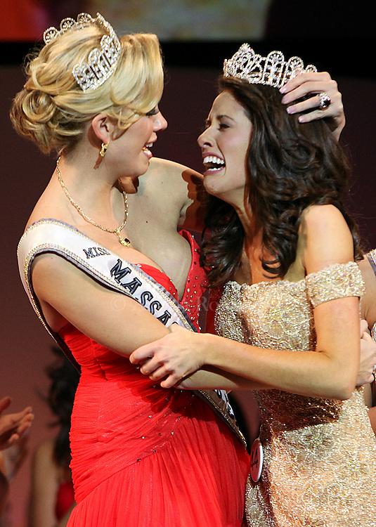 (112810  Lowell, MA) Brooke Bibeault, Miss Massachusetts Teen USA 2010 embraces Kay Tetreault, the new Miss Massachusetts Teen USA, Sunday,  November 28, 2010.  Staff photo by Angela Rowlings.