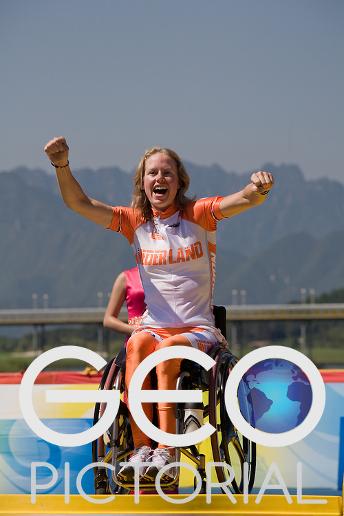 BEIJING, SEPTEMBER 12: Monique Van Der Vorst of The Netherlands celebrates on the podium with her silver medal for the women's Road Cycling Road Race Handcycling (HC A) at the Triathlon Venue during day six of the 2008 Paralympic Games on September 12, 2008 in Beijing, China.