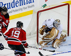 Nov 9, 2008; Newark, NJ, USA; Edmonton Oilers goalie Jeff Drouin-Deslauriers (38) makes a save on a shot by New Jersey Devils center Travis Zajac (19) during the third period at the Prudential Center. The Oilers defeated the Devils 2-1.