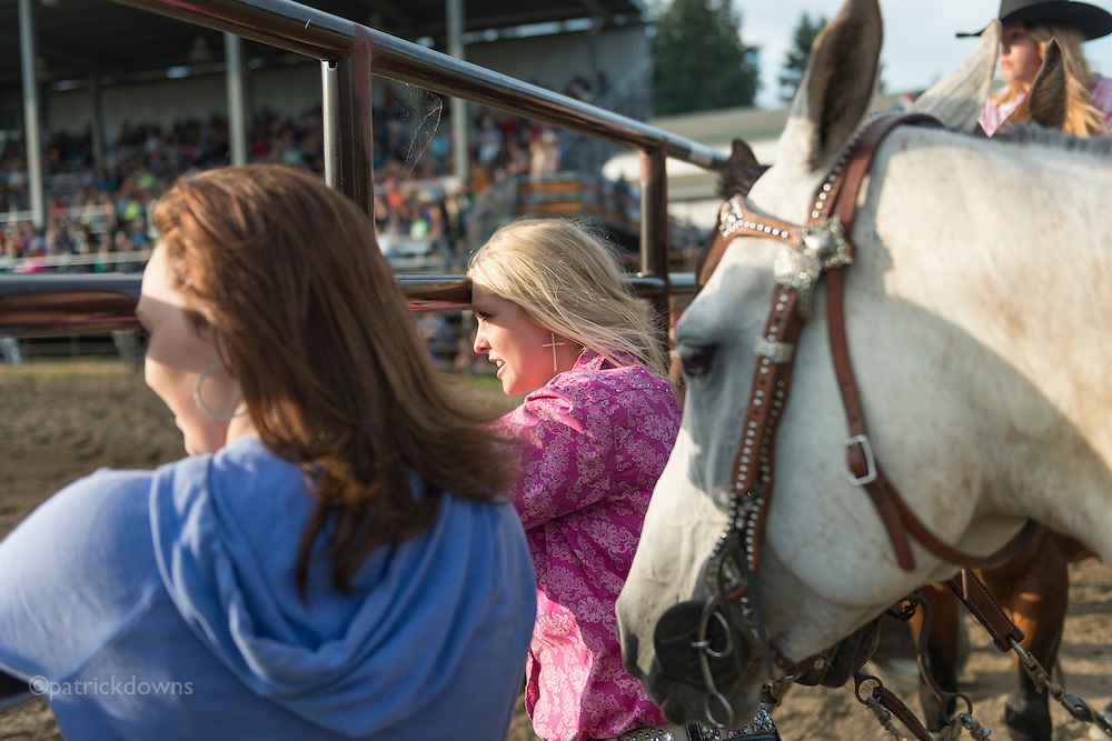 Barrel racer Emily Vanausdle, watching the competition race at the Clallam County Fair rodeo.