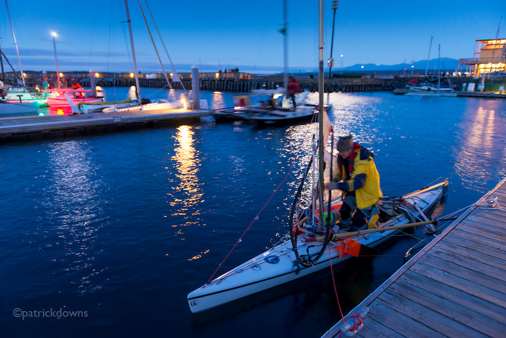 Racers do final preparation for the start of the race, at about 4am under the moonlight.<br /> <br /> Image from the 1st R2AK, Port Townsend's Race to Alaska. All the boats are wind and/or human powered (oars, paddles, pedals) ... no motors allowed. The race kicked off June 4, 2015, with the 1st leg to Victoria, B.C. http://r2ak.com/