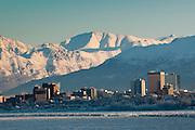 The Chugach Range rises above the downtown skyline of Anchorage, Alaska.