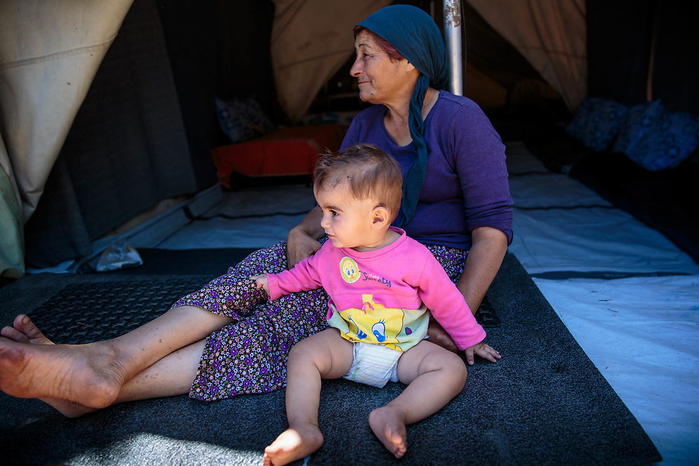 Afadee and her grandson, Deyar, 1, are Syrian Kurdish refugees from Aleppo, Syria. They and their extended family have been living in Ritsona for four months. Ritsona refugee camp, Ritsona, Greece. July 2016.
