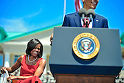 First lady Michelle Obama reacts to remarks made by her husband US President Barack Obama as he addresses a group of soldiers from the US Army 3rd Infantry Division in Fort Stewart, Georgia, USA, 27 April 2012. The president and first lady visited the division headquarters where the he signed an executive order mandating several new education protections for military service members. EPA/STEPHEN MORTON