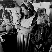 Mennonite Missionary family living out of school bus in San Quentin, Mexico.  1997