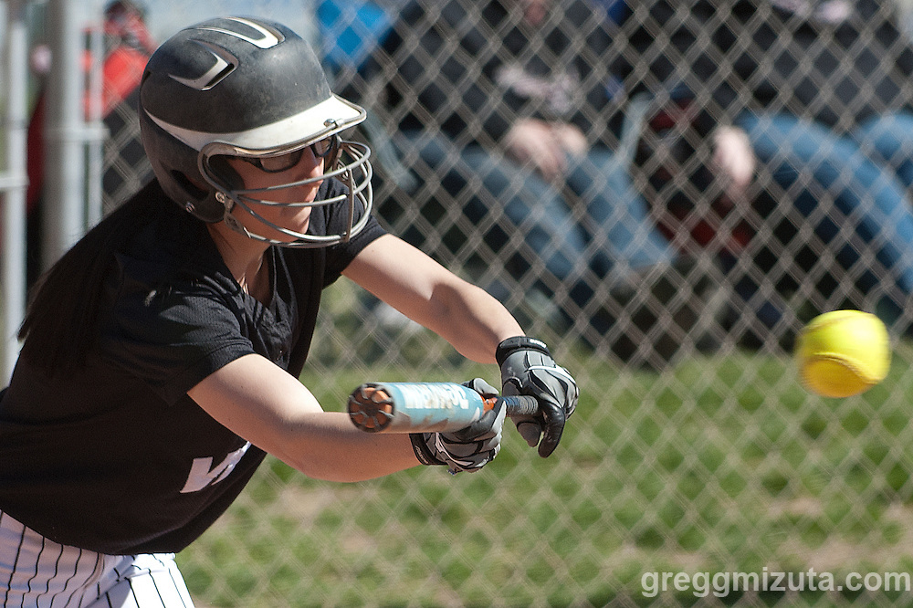 Sasha Morcom bunts during the Vale Payette softball game, March 22, 2014 at Payette, Idaho.