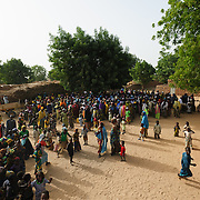 A crowd turns out to watch community health workers conduct malnutrition screening in the village of Nakaidabo in the Tessaoua region of Niger.