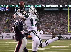 Sept 19, 2011; East Rutherford, NJ, USA; New York Jets wide receiver Braylon Edwards (17) catches a two point conversion over New England Patriots cornerback Darius Butler (28) during the 2nd half at the New Meadowlands Stadium.  The Jets defeated the Patriots 28-14.