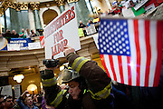 Union firefighters march into the State Capitol on February 23, 2011 in Madison, Wisconsin.