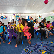 """Fun at the Mercy Corps child friendly space """"Tom and Jerry"""" helps the children adjust to their situation as refugees. Azraq camp for Syrian refugees, Jordan, May 2015."""