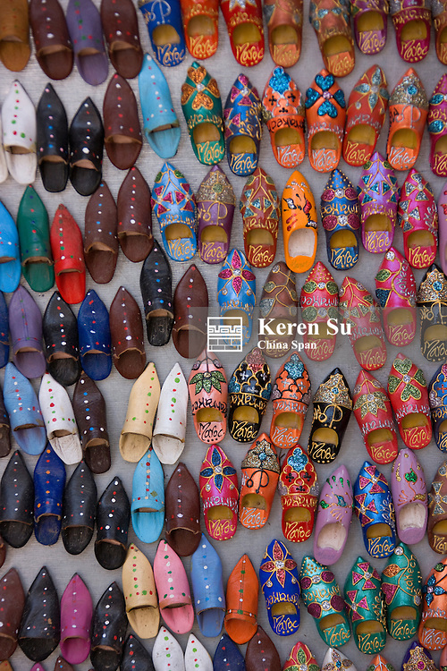 Selling shoes in the old medina, Marrakech, Morocco