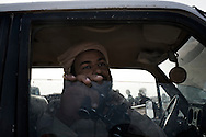 LIBYAN ARAB JAMAHIRIYA, Gualish : A Libyan rebel fighter stays in a car on  the front line by near the southwest desert hamlet of Gualish as rebels repel an attack from forces loyal to Moamer Kadhafi aimed at capturing the city on July 24, 2011.ALESSIO ROMENZI
