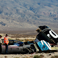 MOJAVE, CA - NOVEMBER 2 : Sheriff's deputies inspect the wreckage from the SpaceShip2 sits out in a desert field North of Mojave, California onSunday, November 2, 2014 in Mojave, CA.  The Virgin Galactic SpaceShip 2 while was being develpoed by Richard Branson, crashed on Friday killing one and injurung One. (Photo by Sandy Huffaker/Getty Images)